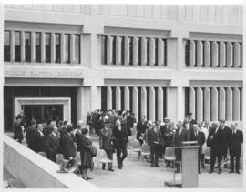 Exterior of Public Safety Building, showing front entrance and platform set up for ceremony, podi...