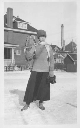 Woman setting out with snowshoes - January 1918