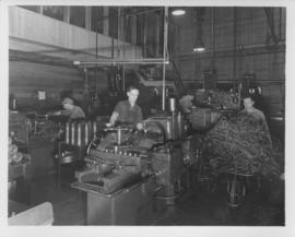 Workmen grinding shell cases and working with machines at Dominion Bridge Company