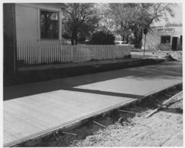 Pavement construction Project E, Ness Avenue (between Queen Street and Bradford Street), south lane of south roadway, October 3, 1962