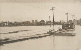 Group of people on barge with flood waters all around, 1916 Flood, Norwood