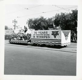 Winnipeg's 75th Anniversary parade - Y.M.C.A. float