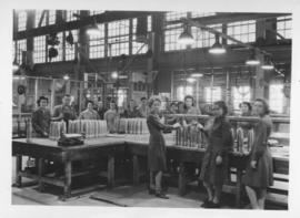 Female workers at workstations with shell cases, Dominion Bridge Company