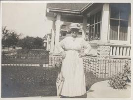 Mother in front of 49 Balmoral Place