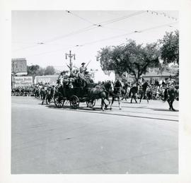 Winnipeg's 75th Anniversary parade - armed men on stagecoach