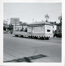 Winnipeg's 75th Anniversary parade - E.J. Casey Shows float