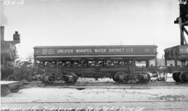 Side view of 20 cubic yard air dump car