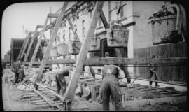 View of men mucking trench for 48-inch diameter Branch 1 aqueduct at Sta. 169+00 on Pacific Avenue