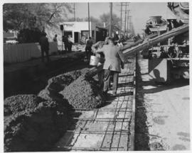 Pavement construction Project E, Ness Avenue (Queen Street and Bradford Street), south lane of south roadway, October 3, 1962