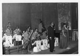 Louis Armstrong with his band and singer
