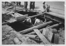 No. 12 Sewer cave-in on Main Street at River Avenue showing undermining of south bound street car...