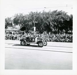 "Winnipeg's 75th Anniversary parade - car with skull and crossbones labelled ""Dunc Johnny"""