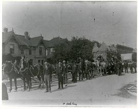 Horses and men leading novelty carriage