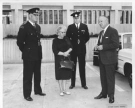 Mayor Stephen Juba and Alderman Lillian Hallonquist with two Police personnel in parking lot in f...