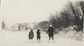Two boys and woman on snowshoes