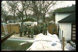 1997 flood - Scotia Street - military personnel removing dike