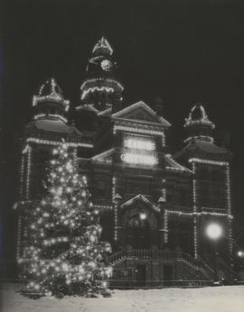 Winnipeg City Hall at night, decorated with lights for holiday season