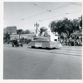 Winnipeg's 75th Anniversary parade - National Motors float