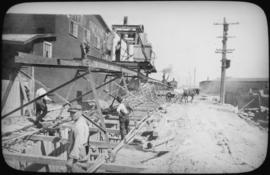 View of mucking hoist hauling excavated material to dump wagon on Pacific Avenue, looking east to...