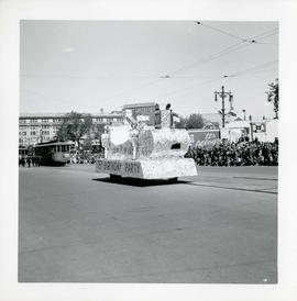 Winnipeg's 75th Anniversary parade - unknown float followed by street cars
