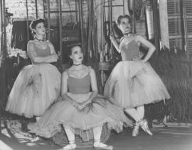 Helen Robertson, Sheila Killough and Viola Busday, members of the Winnipeg Ballet, backstage during pause in performance at Playhouse Theatre