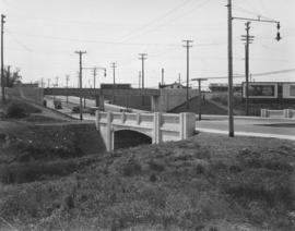 Bridge over Omands Creek on Portage Avenue, looking west to Polo Park