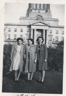 Three students from Normal School standing in front of Legislative Building