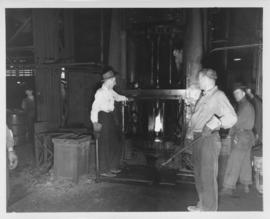Workmen at melting furnace, Dominion Bridge Company