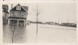 Flood water over front porch of home, 1916 Flood, Norwood