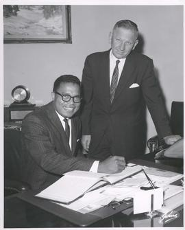 Mayor Stephen Juba and Singer Roy Petty signing Guest Book in Mayor's Office, July 27, 1961