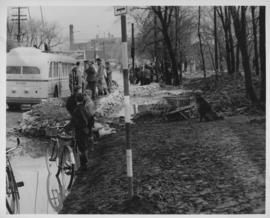 Children, dog and workers helping in the dyking effort in the vicinity of Shaarey Zedek Synagogue, 1950 Flood
