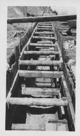 Wooden supports in trench