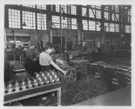Man grinding shell cases at Dominion Bridge Company