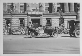 Automobile, clowns, Winnipeg's 75th Anniversary Parade