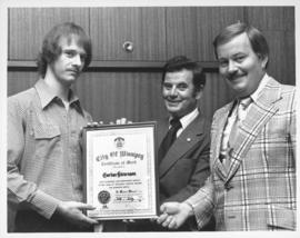 Certificate of Merit being awarded to Gordon Stevenson by Mayor Robert Steen and Councillor Jim E...