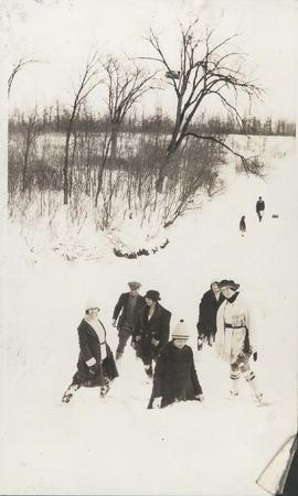 Group standing in deep snow