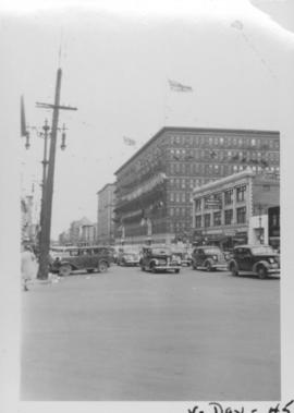 V Day in Winnipeg showing Portage Avenue and Eaton's building in background
