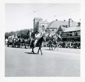 Winnipeg's 75th Anniversary parade - boy on horseback waving