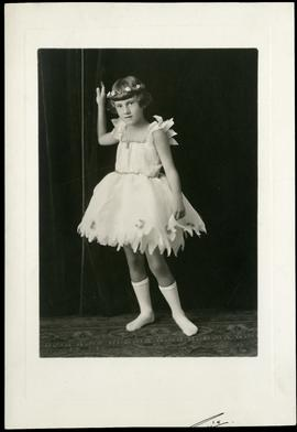 A young dancer in costume