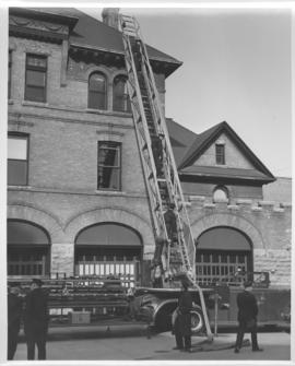 Winnipeg Fire Department aerial ladder truck in front of fire station