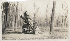 Woman sitting on artillery gun in Kildonan Park