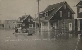 Rue Langevin, St. Boniface under water floods April 1916, showing men in boat