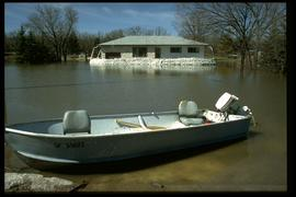 1997 flood - Pembina Highway - boat at house