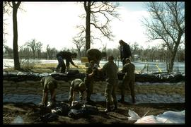 1997 flood - Kildonan Park - military personnel building a dike