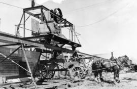 View of mucking hoist dumping excavated material into dump wagon at Sta. 81+00 on Pacific Avenue,...