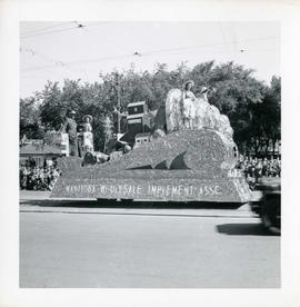 Winnipeg's 75th Anniversary parade - Manitoba Wholesale Implement Association float