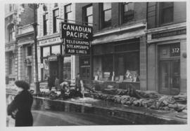 No. 9 Main Street at Portage Avenue showing a few of the many pumping units being used to pump ou...